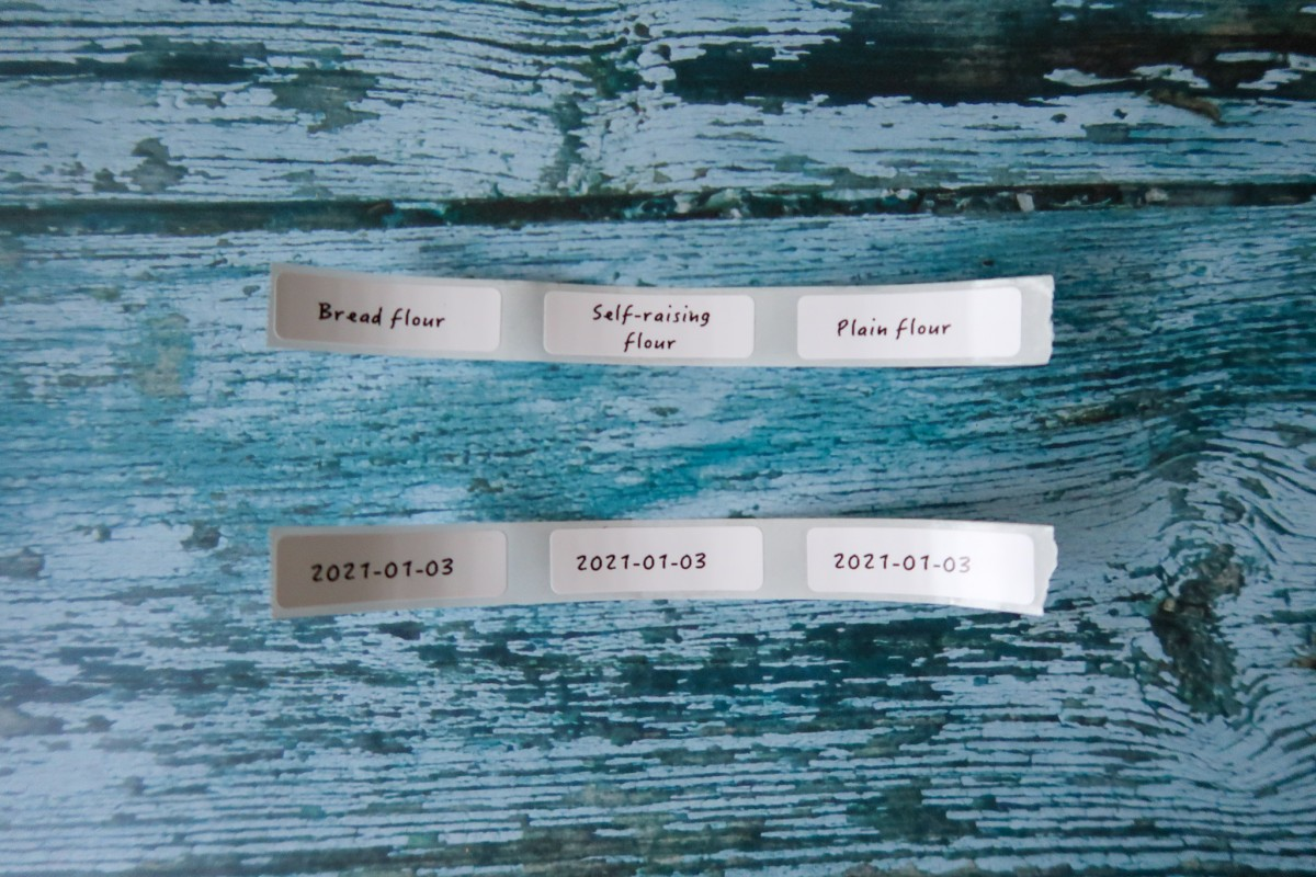Labels for bread flour, self-raising flour, plain flour and dates to show when the items were opened