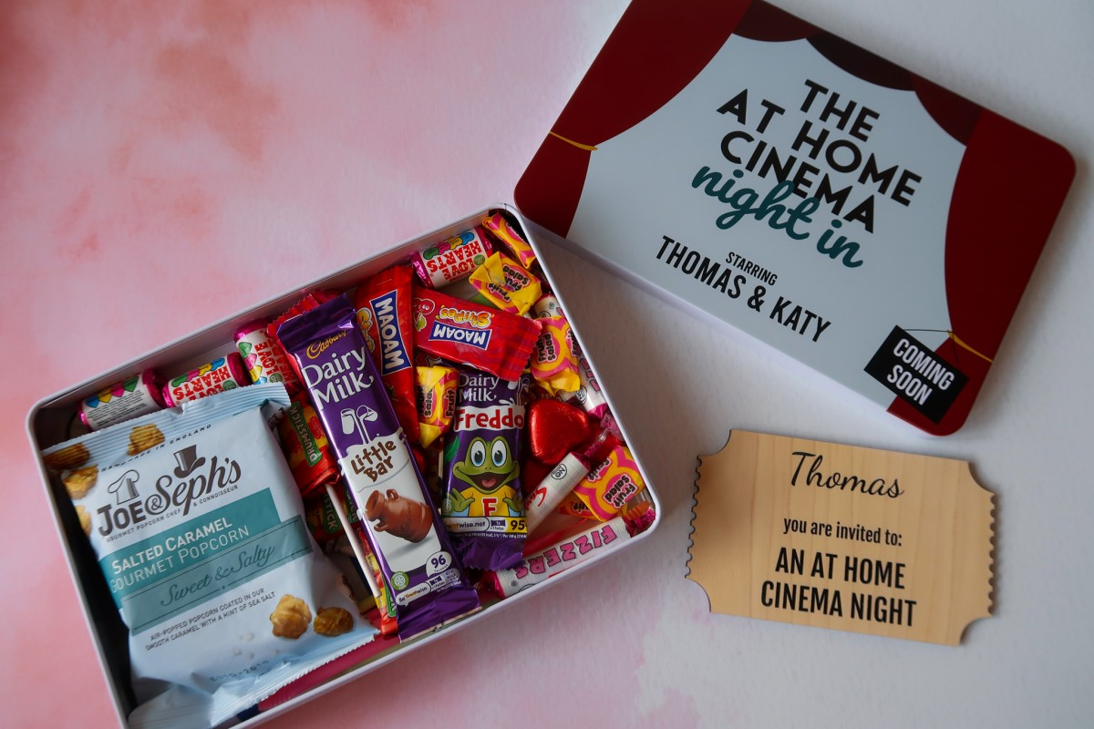 A look at the contents of the Proper Goose Cinema Tin which features popcorn, sweets, chocolates, lollipops and a wooden invitation to an at home cinema night