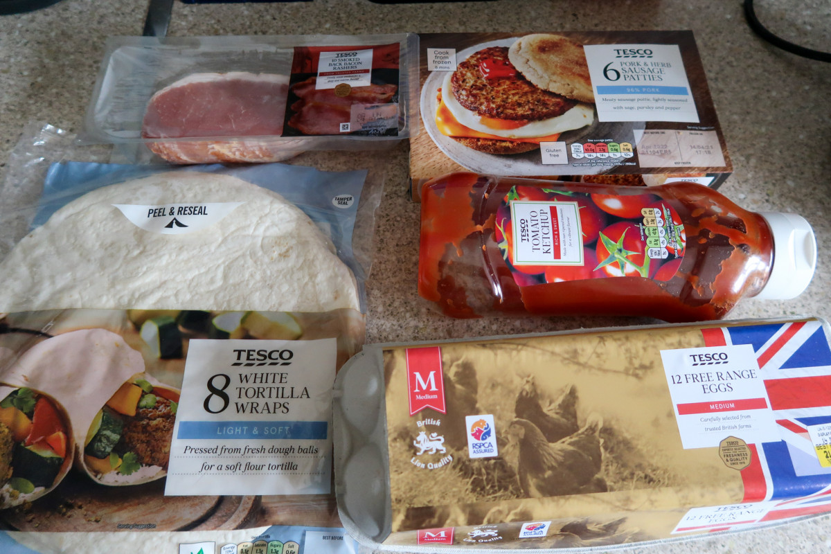 Ingredients for bacon, sausage and egg wrap - bacon, sausage patties, tortilla wraps, tomato ketchup and free range eggs