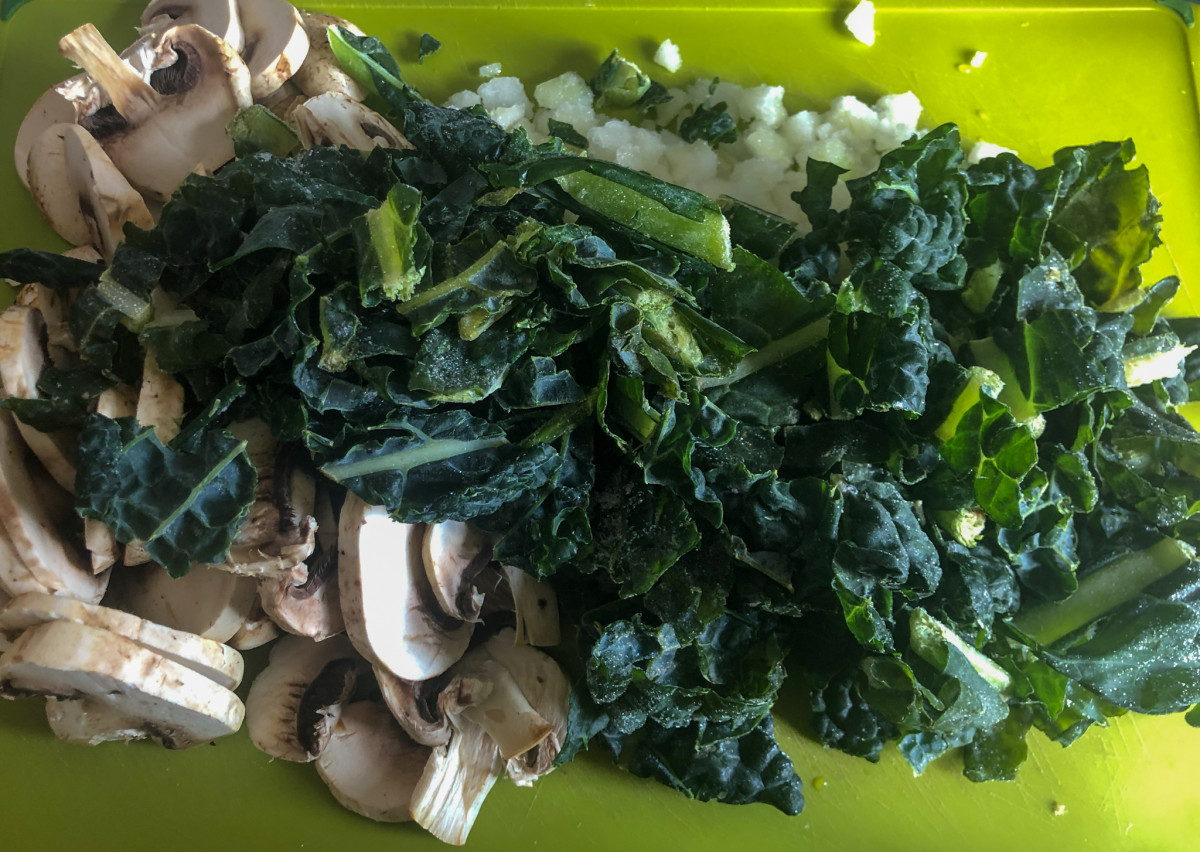 Ingredients for kale tomato pasta sauce - mushrooms, onions, garlic and kale