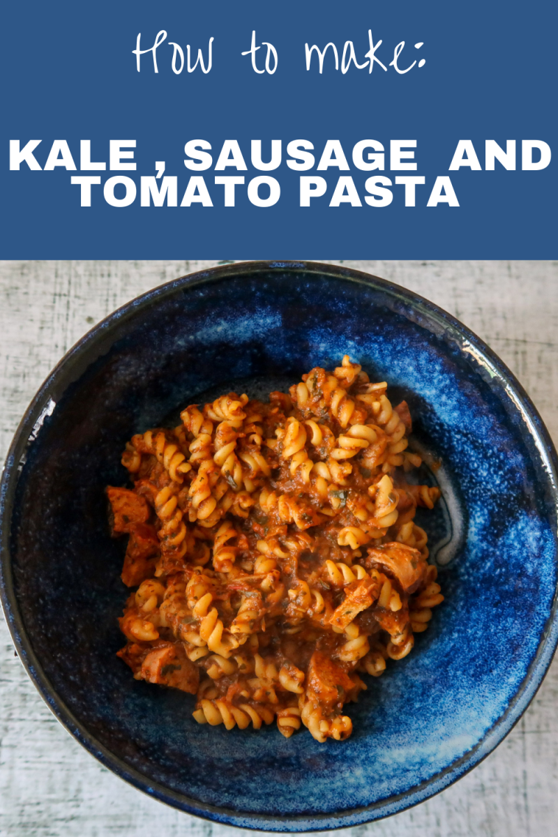 Kale, sausage and tomato pasta in a blue bowl