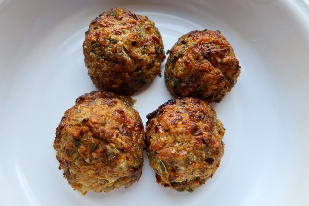Cooked sage and onion stuffing balls in a dish